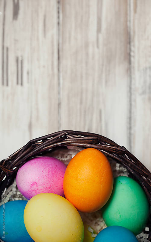 Easter: Colored Easter Eggs With Wooden Background by Sean Locke for Stocksy United