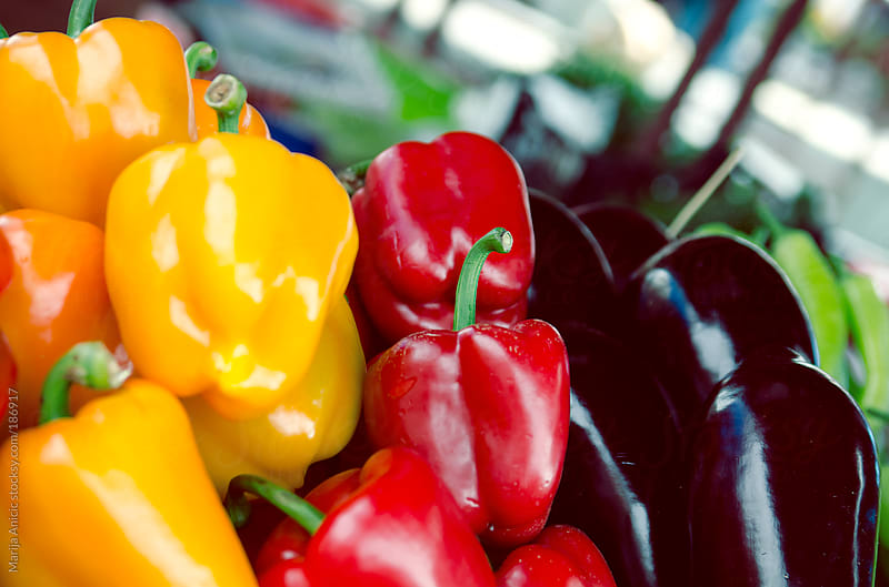 Eggplants,red and yellow peppers on the market by Marija Anicic for Stocksy United