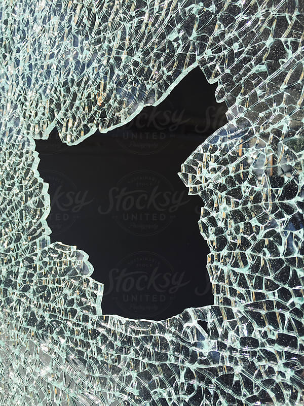 Detail of broken and shattered car window by Paul Edmondson for Stocksy United