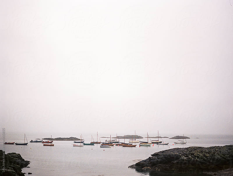 little boats on a foggy day by Léa Jones for Stocksy United