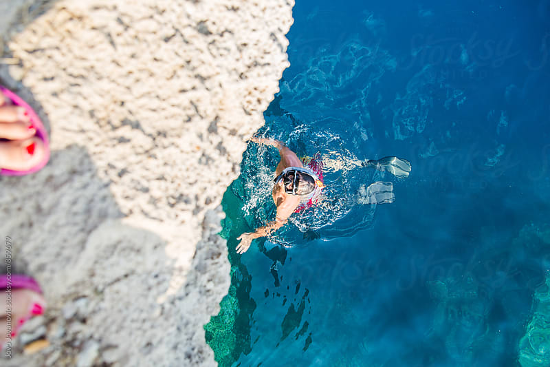 Man snorkeling seen from above  by Jovo Jovanovic for Stocksy United