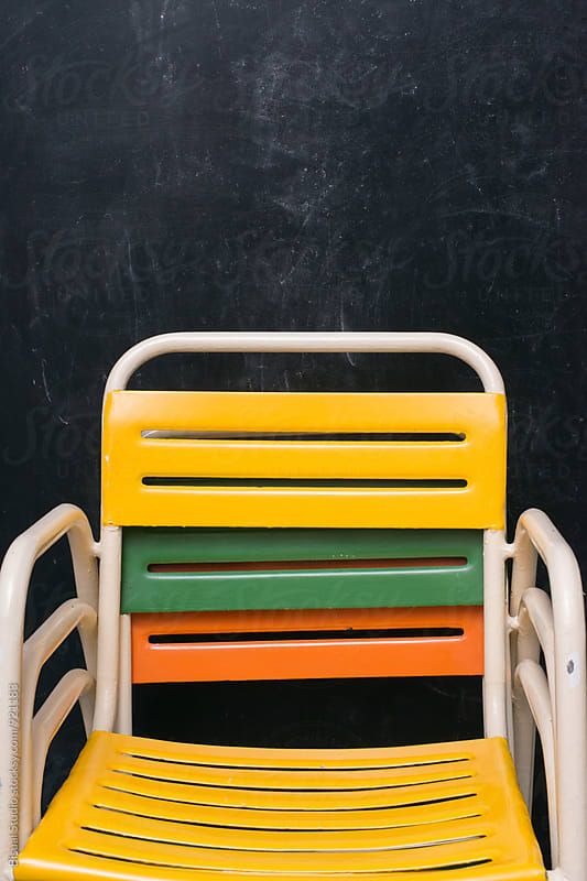 Colorful chairs stacked by Bisual Studio for Stocksy United