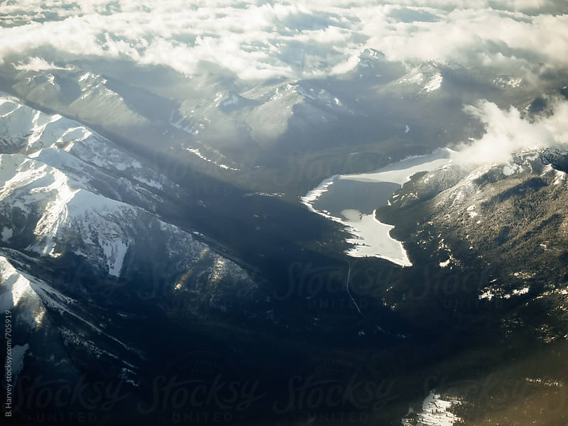 Mountains and Frozen Lake Viewed From the Sky by B. Harvey for Stocksy United