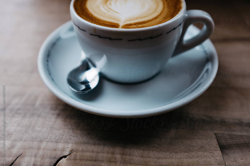 A cappuccino with nice latte art. by Dylan M Howell Photography for Stocksy United