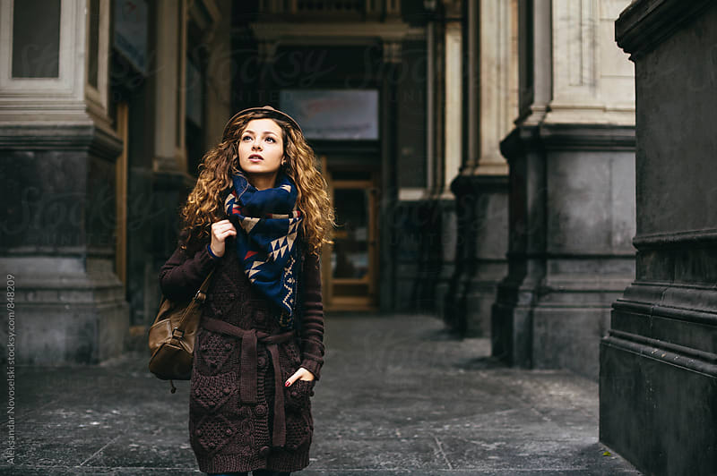 Young woman with hat and scarf walking around Naples, Italy by Aleksandar Novoselski for Stocksy United