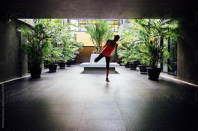 Woman Stretching Before Workout by Nemanja Glumac for Stocksy United
