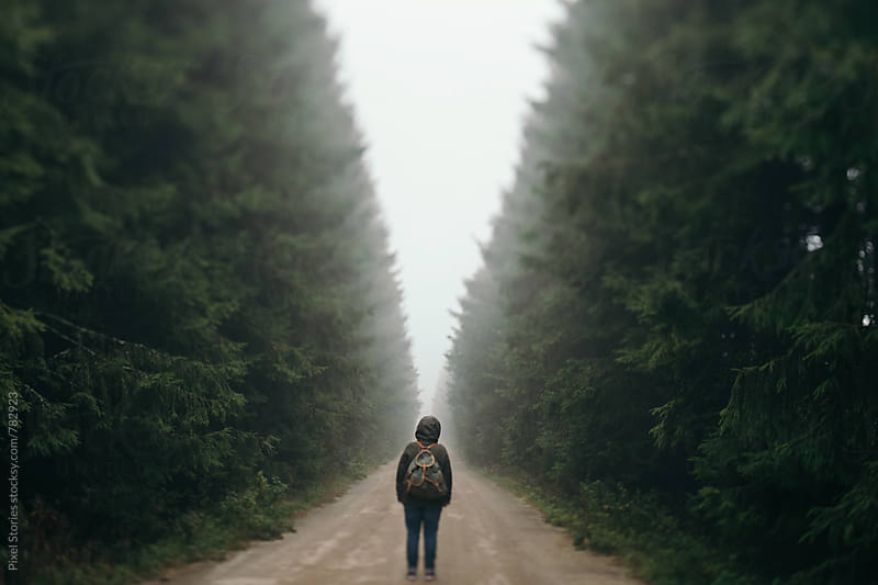 Person standing on a road by Pixel Stories for Stocksy United
