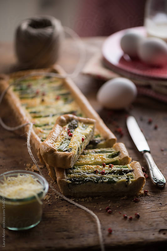 quiche with asparagus  sliced  by Laura Adani for Stocksy United