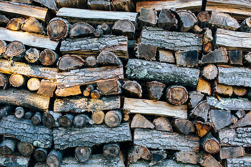 Stack of Firewood piled for Winter. by Holly Clark for Stocksy United