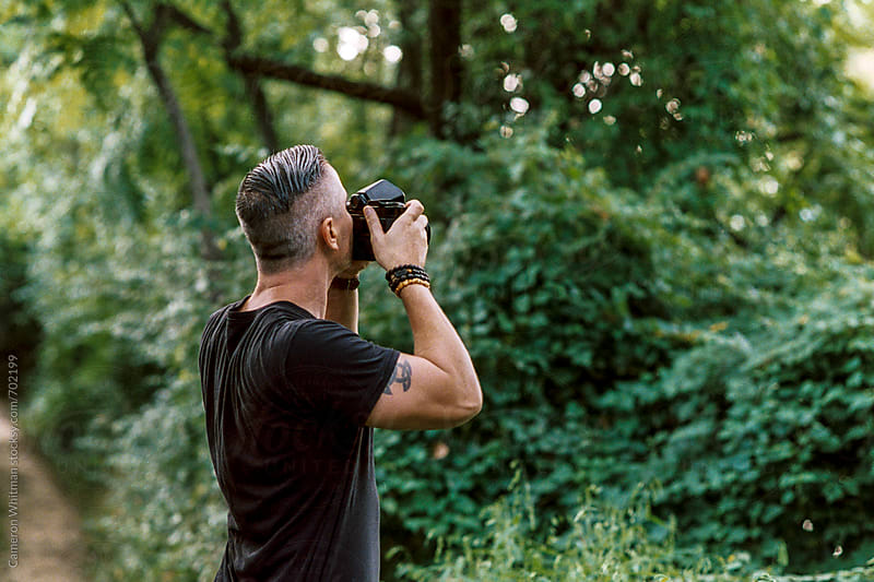 Hip photographer exploring nature by Cameron Whitman for Stocksy United