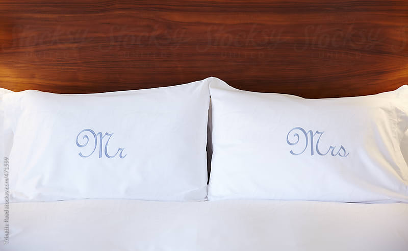 Pillows at luxury hotel with Mr And Mrs printed on them  by Trinette Reed for Stocksy United