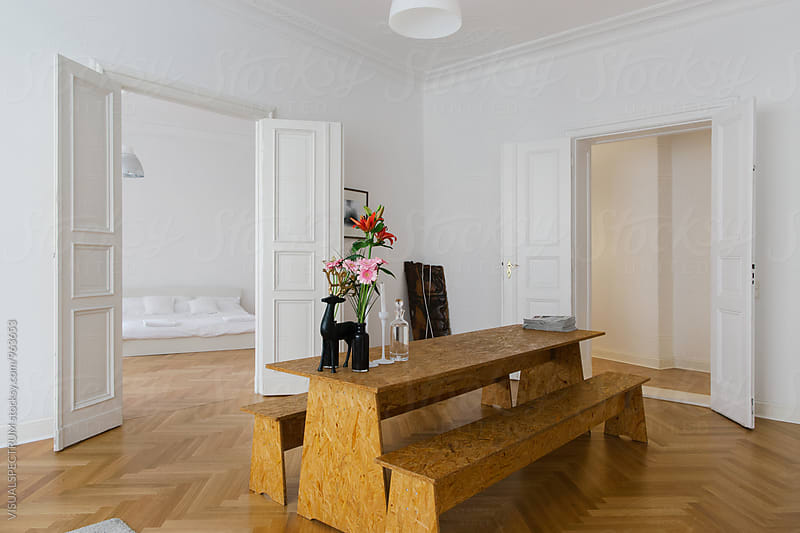 Large Table in Bright White Stylish Apartment Living Room by Julien L. Balmer for Stocksy United