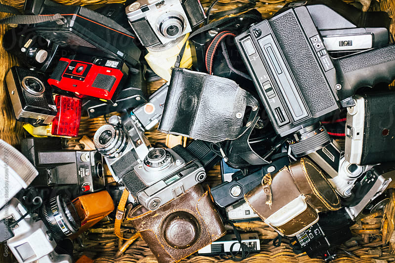 Collection of vintage cameras in a flea market by Good Vibrations Images for Stocksy United
