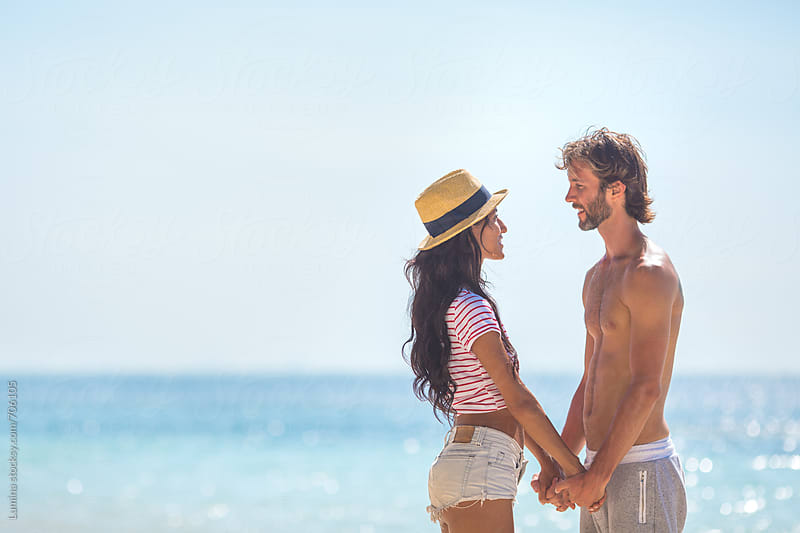 Romantic Couple on the Beach by Lumina for Stocksy United