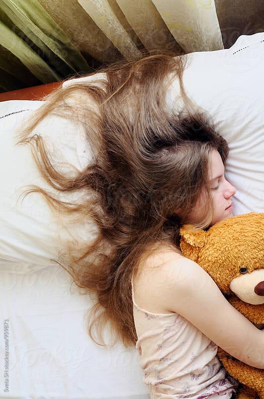 Young girl in her bed by Svetlana Shchemeleva for Stocksy United