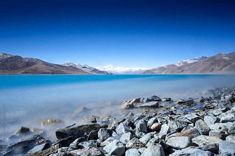 A very blue lake..... by James Tarry for Stocksy United