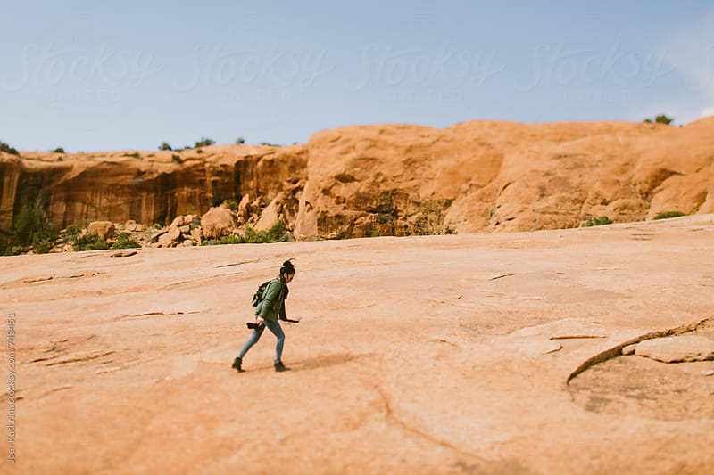 girl hiking up a canyon. by Joe+Kathrina for Stocksy United