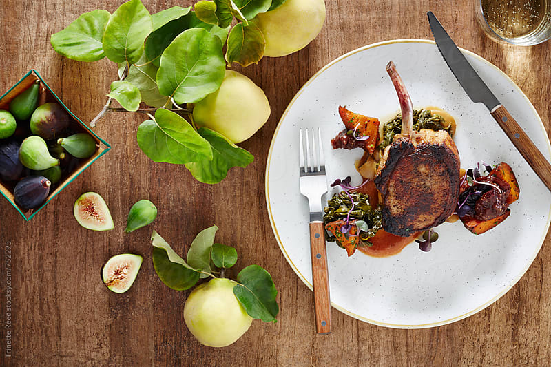 Pork Chop with Quince and Fig by Trinette Reed for Stocksy United