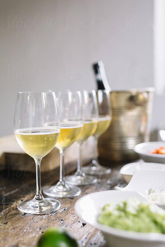 Detail of white Wine Glasses by Alberto Bogo for Stocksy United
