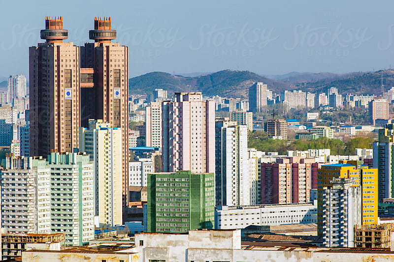 Democratic Peoples's Republic of Korea (DPRK), North Korea, Pyongyang, city centre apartments and the Koryo Hotel by Gavin Hellier for Stocksy United