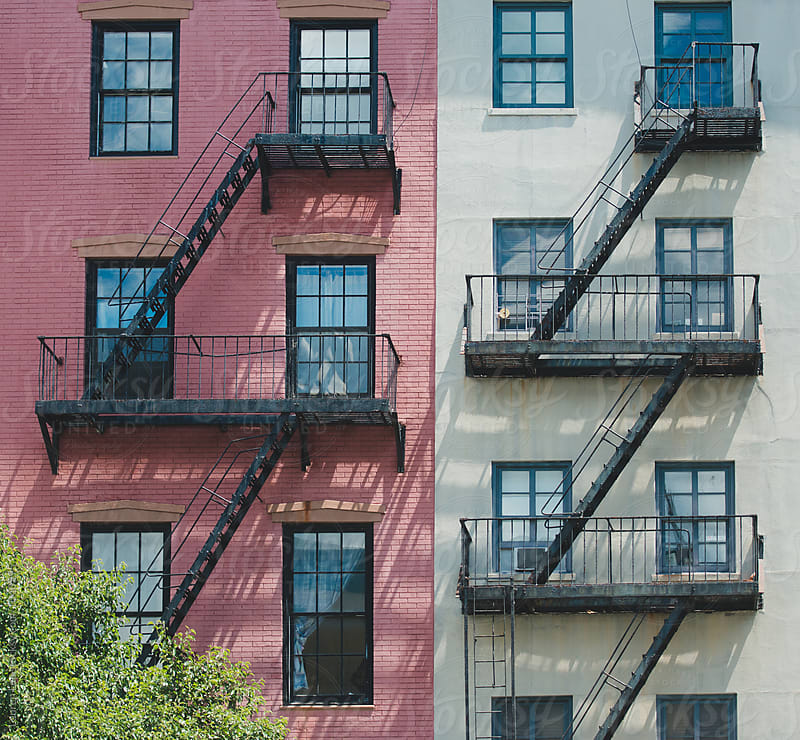 Apartment building and fire escapes in the city by Lauren Naefe for Stocksy United