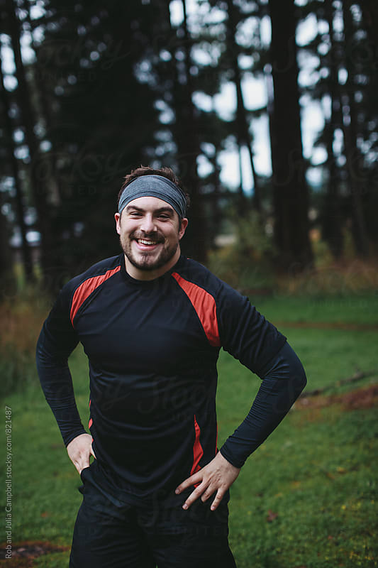 Post workout portrait of young caucasian man - smiling outside  by Rob and Julia Campbell for Stocksy United