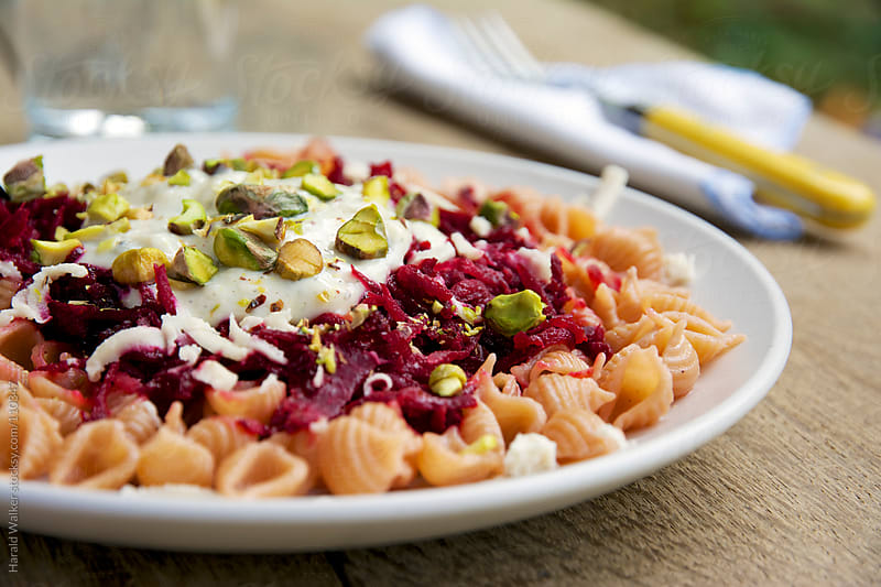 Red beet on pasta by Harald Walker for Stocksy United