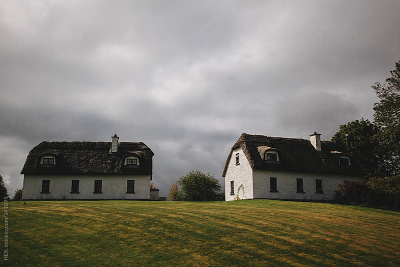 Irish Cottages under Cloudy Sky by HEX. for Stocksy United