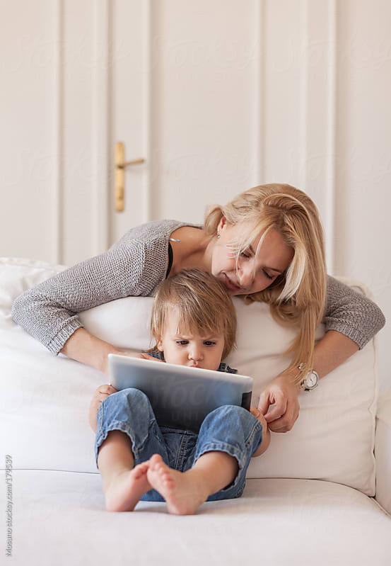 Mother and Son Using Technology by Mosuno for Stocksy United