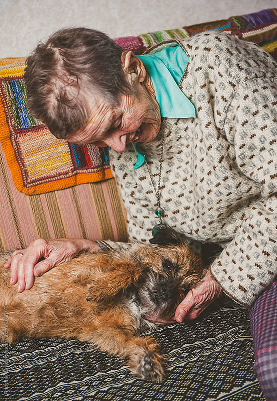 elderly woman and her dog by Andreas Gradin for Stocksy United