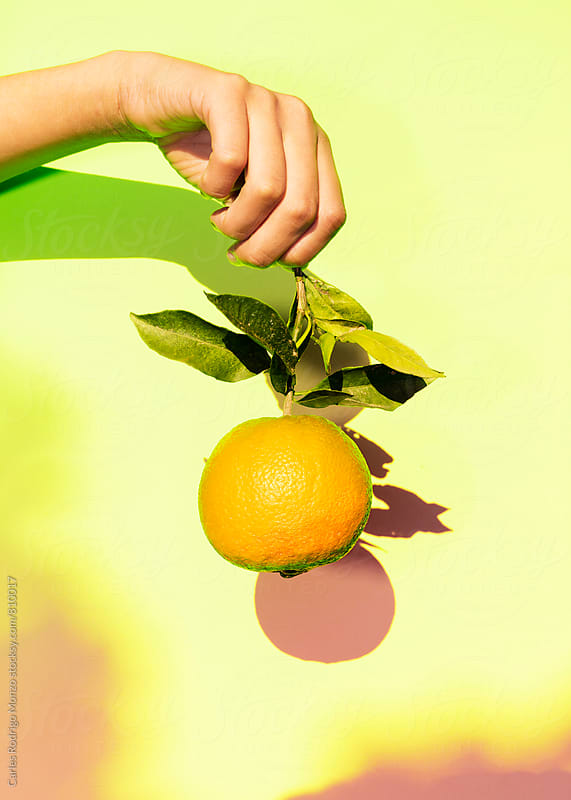 Fruit and hand by Carles Rodrigo Monzo for Stocksy United