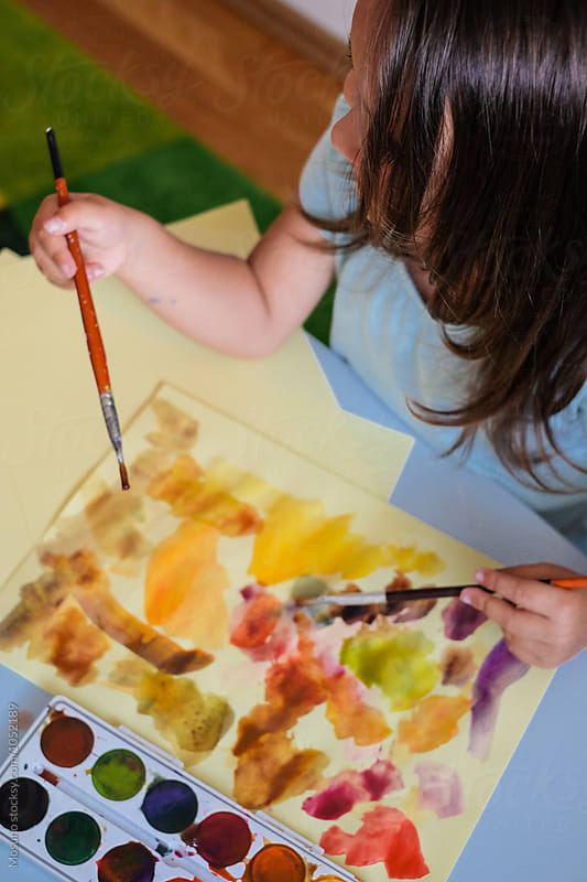 Anonymous Girl Painting with Watercolours by Mosuno for Stocksy United