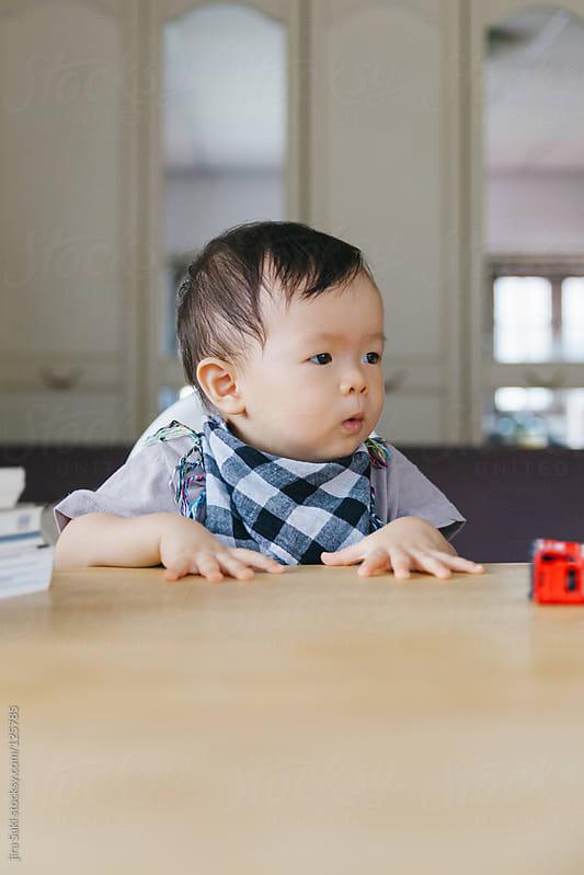 baby boy by jira Saki for Stocksy United