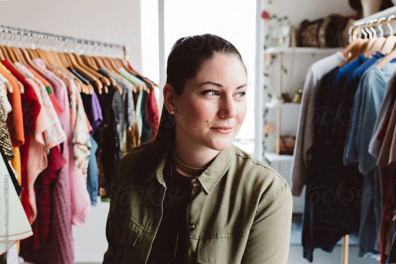 Portrait of female entrepreneur in her clothing boutique by Carey Shaw for Stocksy United