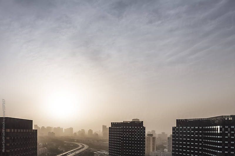 Sunrise over Beijing, with Low Visibility by Helen Sotiriadis for Stocksy United