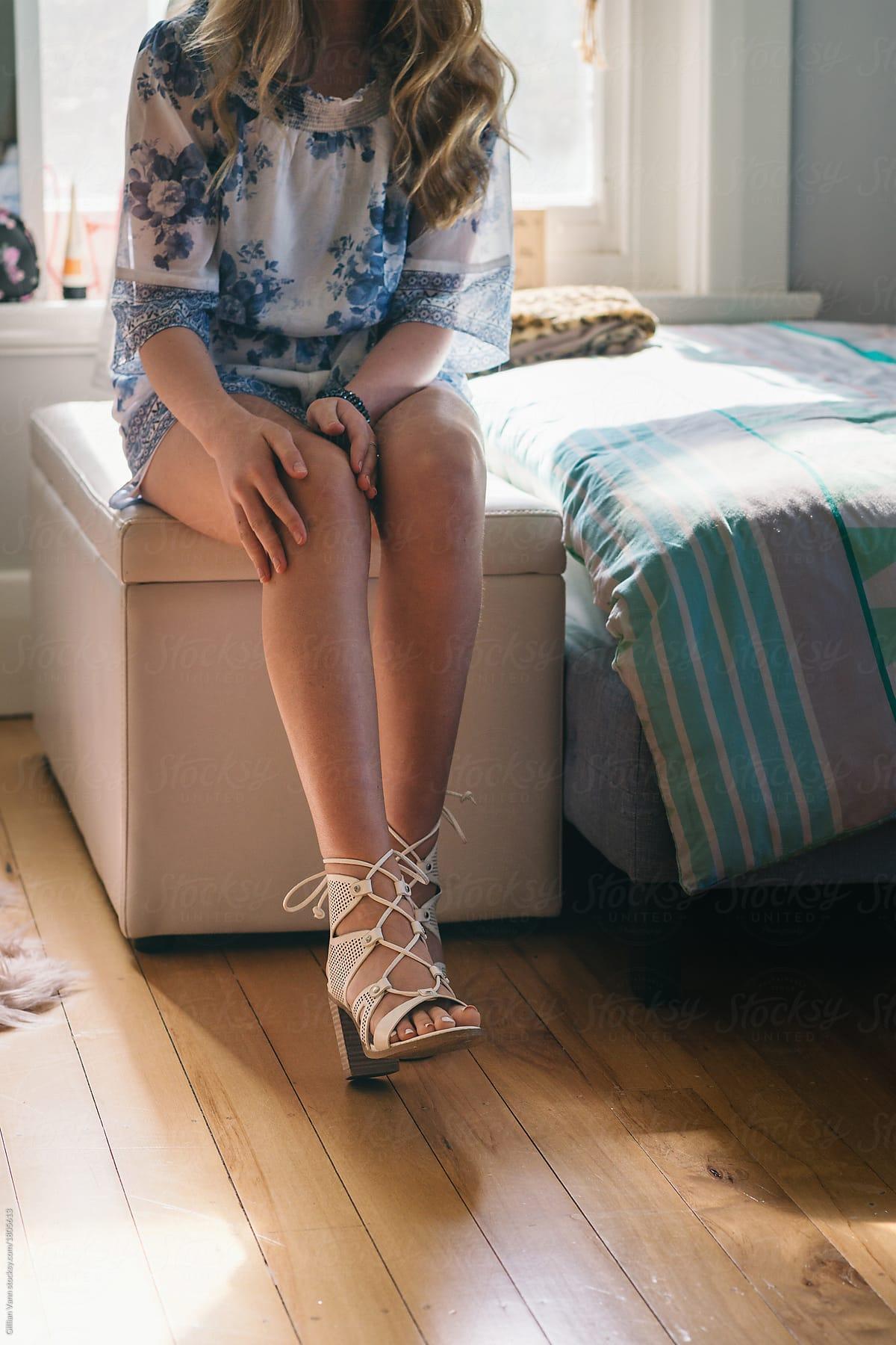cc3ec5fddc07 teen girl in her bedroom putting on high heels by Gillian Vann for Stocksy  United
