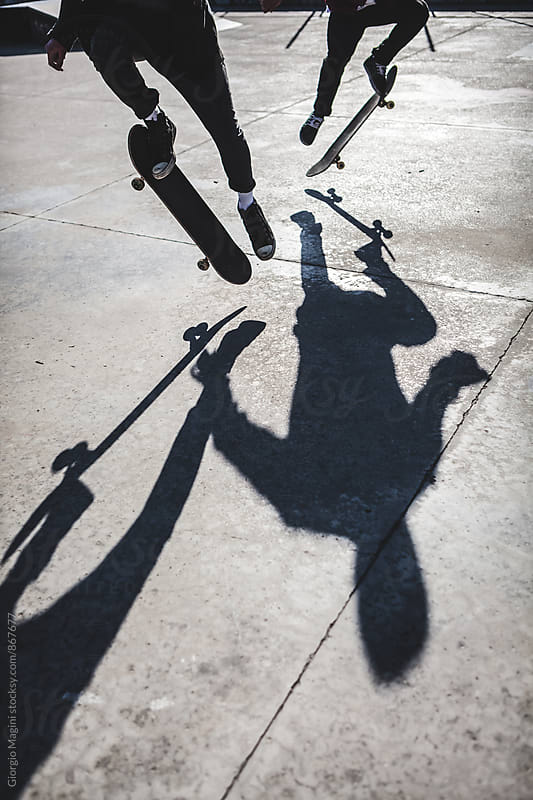 Shadow of Two Skateboarders Jumping at the Skatepark by Giorgio Magini for Stocksy United