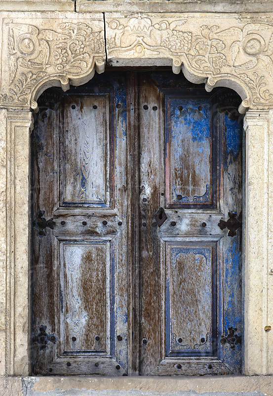 Old blue wooden door with Christian pattern by Pixel Stories for Stocksy United