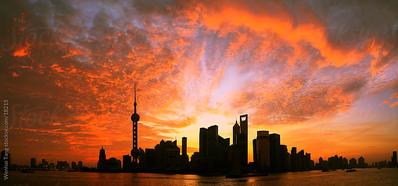 Shanghai Bund skyline at dawn pink clouds by Wenhai Tang for Stocksy United