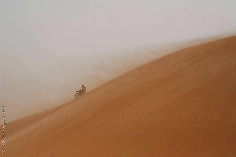 Rally biker on sand dune by Ferenc Boros for Stocksy United