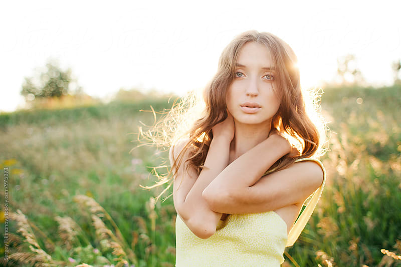 Beautiful young woman looking at the camera  by Sergey Filimonov for Stocksy United