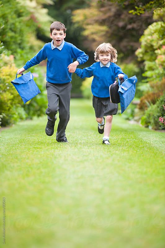 two children in school uniform by Lee Avison for Stocksy United