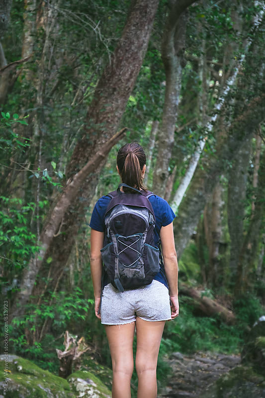 female hiker in a forest by Micky Wiswedel for Stocksy United