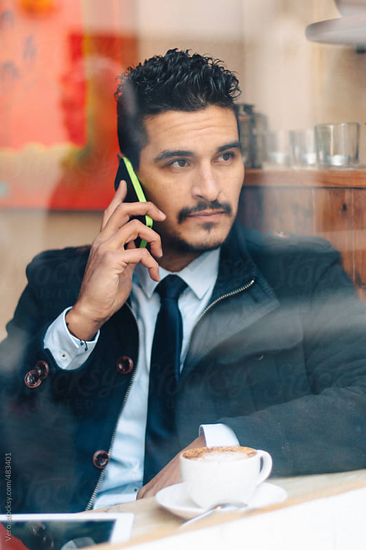 Portrait of a Businessman Working  by Good Vibrations Images for Stocksy United