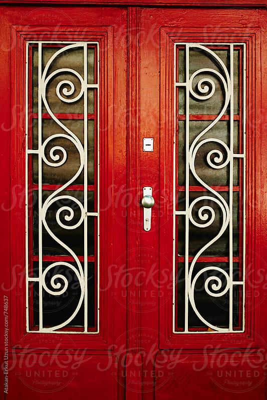 red door by Atakan-Erkut Uzun for Stocksy United