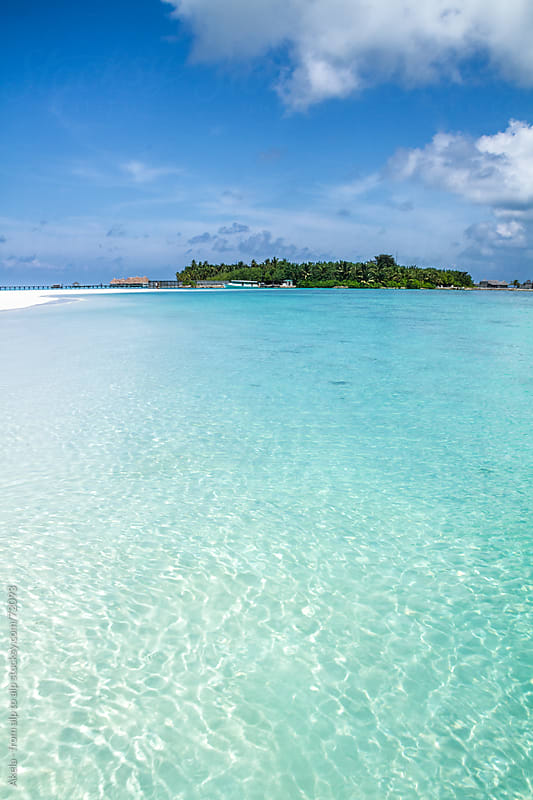 crystal clear water with a white sanded beach  by Leander Nardin for Stocksy United