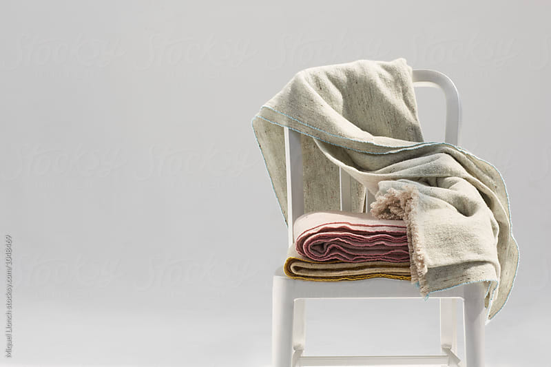 Set of handmade wool blankets on a metallic chair by Miquel Llonch for Stocksy United