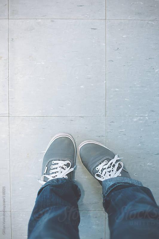 feet in sneakers by Gillian Vann for Stocksy United