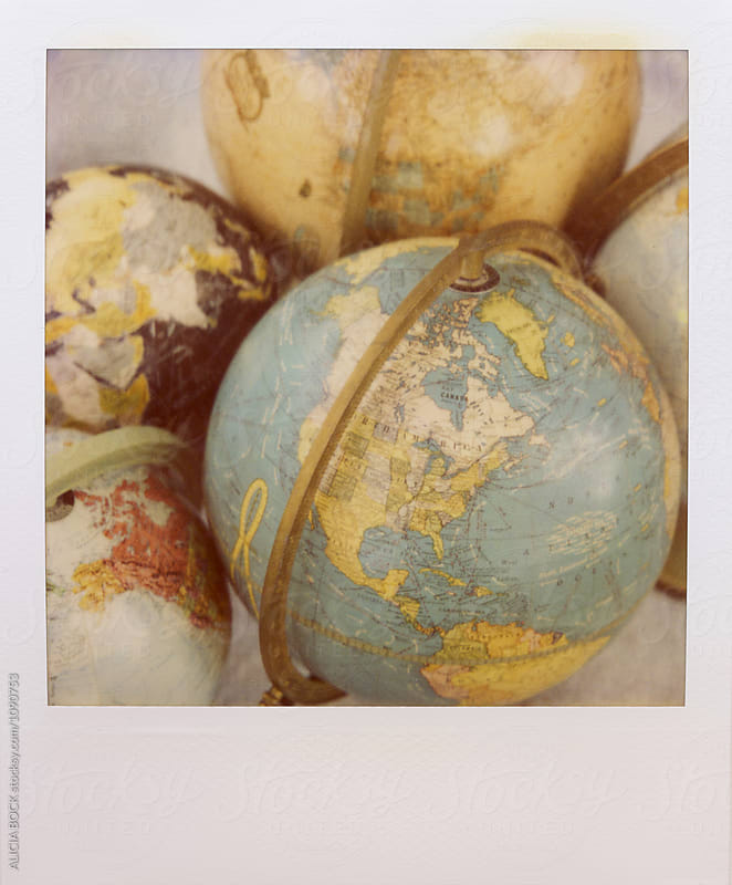 Polaroid Photograph Of A Collection Of Vintage Globes by ALICIA BOCK for Stocksy United