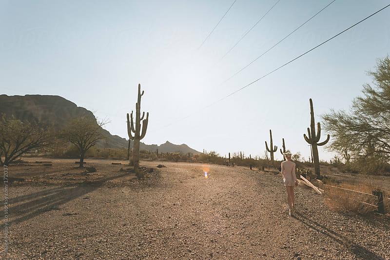 Girl walking in the Arizona Desert by Image Supply Co for Stocksy United